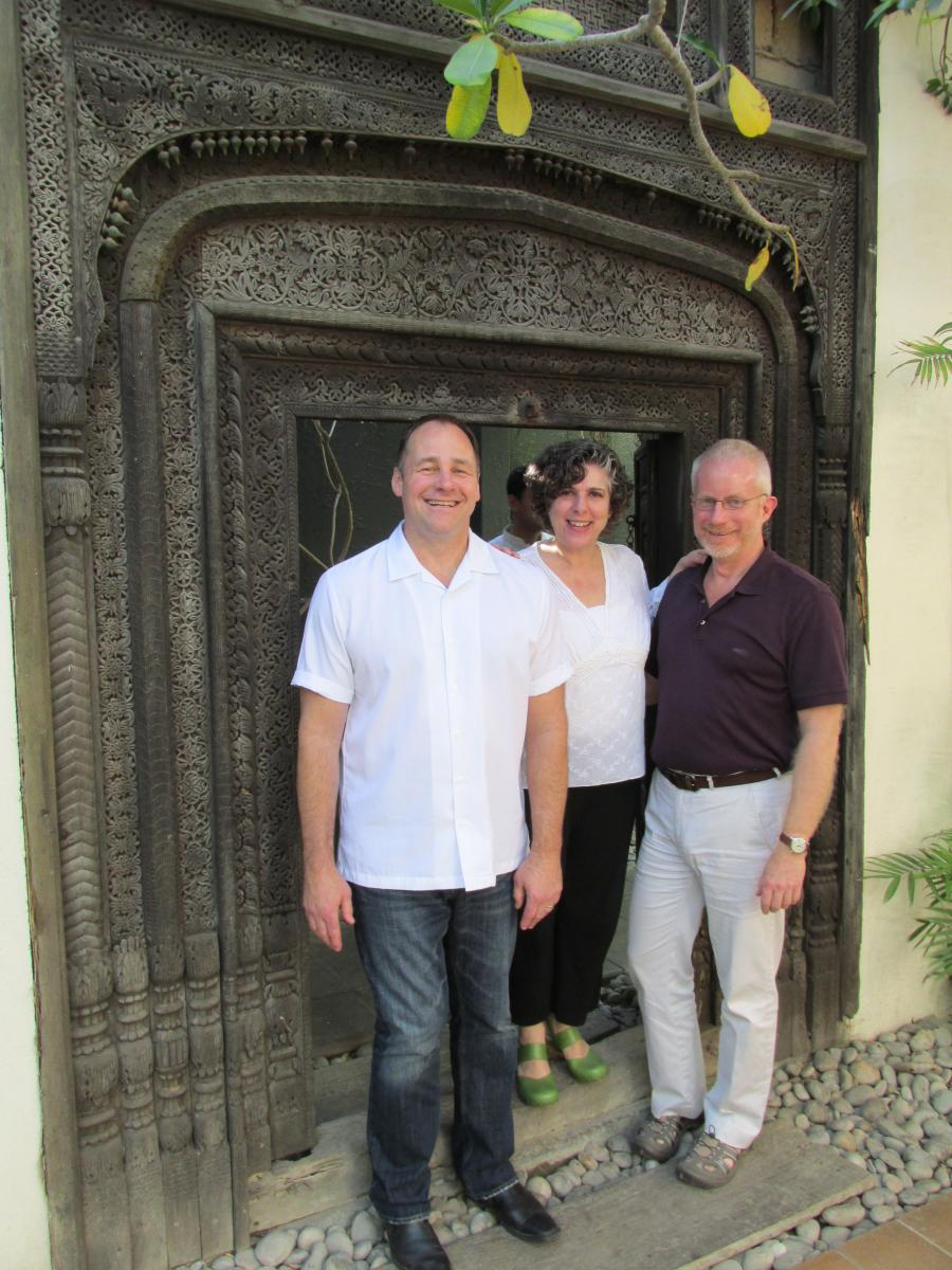 Brian Jose, Deirdre Valente, and Rob Richter step through the hand carved wooden portal at Koel Cafe, Karachi