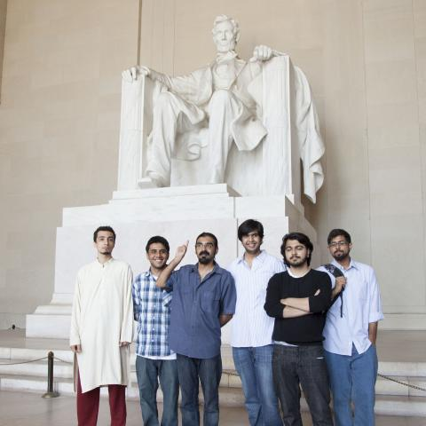 A group of men standing in front of the Lincoln Memorial